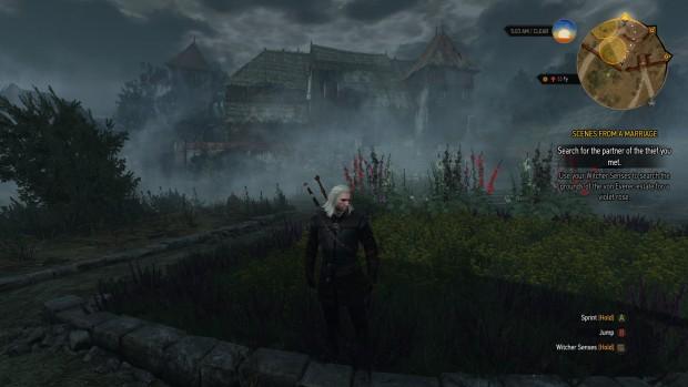 Geralt cammina verso il giocatore, mentre sullo sfondo, tra la nebbia, c'è una magione dalla forma inquietante ed imponente.