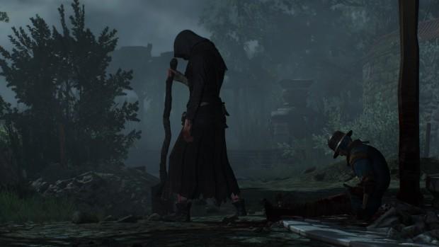 Al centro dell'immagine una quasi silhouette nera che con la testa china in avanti come fosse rassegnata regge quella che sembra una pala appena piantata nel terreno.