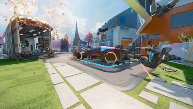Scena di gioco colorata, sembra un'immagine di Ritorno al Futuro parte 2, con un'auto futuristica, il prato verde ben tagliato, edifici bassi dagli angoli un po' arditi, e quello che sembra un gigantesco autolavaggio in fiamme.