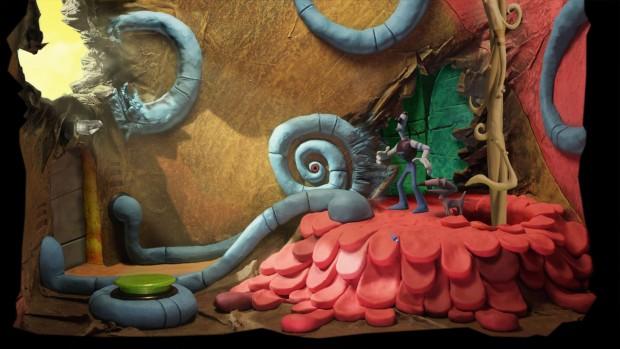 Il protagonista in piedi su una montagnola come di grossi petali rossi, all'interno di una stanza con una finestra sulla sinistra dalla quale filtra la luce gialla.