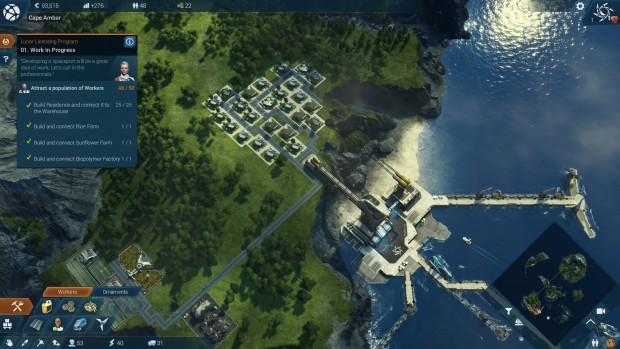 Vista dall'alto di una parte di un'isola, con strutture che si estendono sul mare.